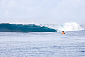 INDONESIA, Mentawai Islands, Kandui Resort, a lone surfer watching a large wave break at Bankvaults