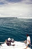INDONESIA, Mentawai Islands, Kandui Resort, watching surfers at Bankvaults from a boat