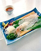 JAPAN, Kyushu, live squid served on Karatsu Pottery, Kai Shu Restaurant