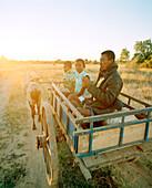 MADAGASCAR, family traveling in ox cart, Beza Mahafaly Tribe