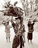 Madagascar, women carrying wood to the market, Perinet, Betsimisaraka Tribe (B&W)