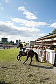 MAURITIUS; Port Louis; an international horse race draws thousands at Champ de Mars Race Cource; International Jockey Day