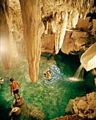 MEXICO, Maya Riviera, man with boys swimming in a Cenote, Taninah Lodge