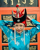 MONGOLIA, Ulaanbaatar, woman performer of traditional Mongolian dance in front of the Abtai-Sain Khan Palace