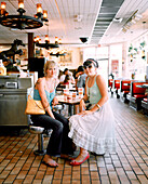 USA, New Mexico, young women sitting in Frontier Restaurant, Albuquerque