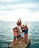 PANAMA, boys on the rocks, Caribbean Sea, Bocas del Toro