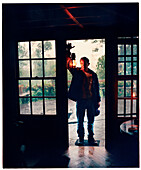 PANAMA, David, Guadalupe, Los Quetzales Lodge, man with a lantern in stays in a Swiss style chalet in the cloud forest, Volcan Baru National Park and Cloud Forest of Friendship International Park, Central America