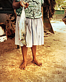 PANAMA, Isla Bastimentos, a woman gets ready to prepare a fish dinner, Central America