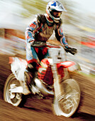USA, Tennessee, boy in a motorcross race, action blur