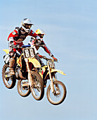 USA, Tennessee, motocross riders getting air and racing for the lead