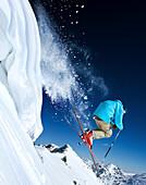 USA, Utah, man skiing off cornice, Early Yellow Trail, Alta Ski Resort