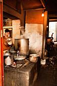 VIETNAM, Hanoi, restaurant Pho Gia Truyen, also known as 49 Bat Dan, a young boy serves pho broth into a bowl