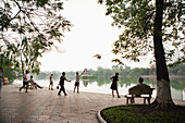 VIETNAM, Hanoi, VIETNAM, Hanoi, people stretch, exercise and walk early in the morning, Hoan Kiem Lake and Pagoda