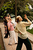 VIETNAM, Hanoi, women practice Tai Chi early in the morning, Hoan Kiem Lake