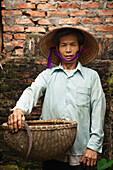 VIETNAM, Hanoi countryside, portrait of rice farmer Nguyen Huu Uc at his home in Nguyen Huu Y village
