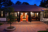 VIETNAM, Hue, Ms. Boi Tran's Hoang Vien restaurant, women in traditional dress await guests