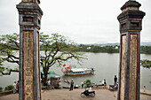 VIETNAM, Hue, a view of the Perfume river and historic Vietnamese architecture in front of an old monastery
