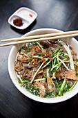 VIETNAM, Hanoi, traditional street food restaurant called Quan An Ngon, Beef Noodle bowl, Banh Ota Ca
