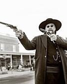 USA, Wyoming, mature man with his guns, Wild Bill Cody Shootout (B&W)