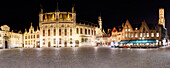 Panorama of the vast castle square in the historic center of Bruges with the Belfry tower in the background, Flanders, Belgium