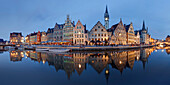 Panorama of the historic guild houses of Graselei with its reflection in the river Lys in the old city of Ghent with the tower of the post office in the background, Gent, Flanders, Belgium