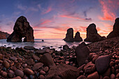 A reddish blaze of colors right after sunset above the rock formations at the Boca do Inferno at the western tip of Europe, Sintra-Cascais National Park, Regiao de Lisboa, Portugal