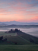 Sunrise over the Val d'Orcia near Pienza on a foggy morning in spring, Pienza, Tuscany, Italy