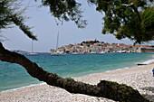 View across a beach towards Primosten, Dalmatia, Adriatic Coast, Croatia