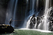Fisherman at Lily waterfall near the village of Ampefy, Madagascar, Africa