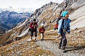 Woman and two girls hiking at Fuorcla Val da Botsch, Swiss National Park, Canton of Grisons, Switzerland