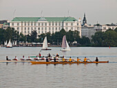 View over the Lake Alster with rowing boats and sailing boats in front of the Atlantic hotel, Hanseatic City of Hamburg, Germany