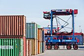 Straddle Carrier transporting containers in the block storage in the port of Hamburg, Hamburg, Germany