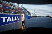 Man entering the MTC shiphandling simulator, Marine Training Center, Hamburg, Germany