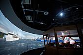 Captains at the MTC shiphandling simulator, Marine Training Center, Hamburg, Germany