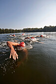 Competitive swimmers training in open water, Boberg swimming lake, Billwerder, Hamburg, Germany