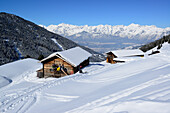 Group of people back-country skiing having a break at snow-covered alpine hut, back-country skiing, Hoher Kopf, Tux Alps, Tyrol, Austria