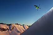 Freestyle skier jumping in a halfpipe, Nebelhorn, Allgau Alps, Bavaria, Germany