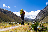 Man hiking on a mountain trail, Tocllaraju, Pashpa, Ishinca Valley, Huaraz, Ancash, Cordillera Blanca, Peru