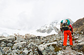 Man ascending to high camp of Ranrapalca, Ishinca Valley, Pashpa, Huaraz, Ancash, Cordillera Blanca, Peru