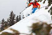 Man downhill skiing in deep snow, Mammoth Mountains, California, USA