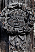 Detail of a carved wooden beam in the former Plague-Ossuary St. Maclou, Rouen, Seine-Maritime, Normandy, France