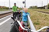 Father and son with bicycles on a platform, Prenzlau, Uckermark, Brandenburg, Germany