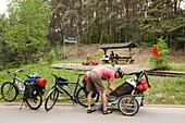 Cyclist resting near draisine station, near Himmelpfort, Uckermark Lakes Nature Park, Brandenburg, Germany