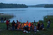 Campfire at campground at lake Ellbogensee, Mecklenburg Lake District, Mecklenburg-Western Pomerania, Germany