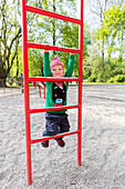 Boy (2 years) at a climbing frame, Clara Zetkin park, Leipzig, Saxony, Germany