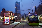 Urban tramway, Abandoibarra, Iberdrola tower, Bilbao, Bizkaia, Basque Country, Spain.