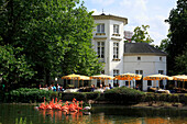 D-Krefeld, Rhine, Lower Rhine, Rhineland, North Rhine-Westphalia, NRW, D-Krefeld-Bockum, Grotenburgschloesschen in the zoological garden Krefeld, Grotenburg castle, gastronomy, sidewalk cafe, sunshades, people, American Flamingoes, Phoenicopterus ruber