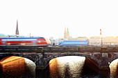 Time lapse view of bus on urban bridge