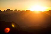 Silhouette of mountains at sunset. Branderschrofen, Tegelberg