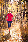 Woman jogging on dirt path